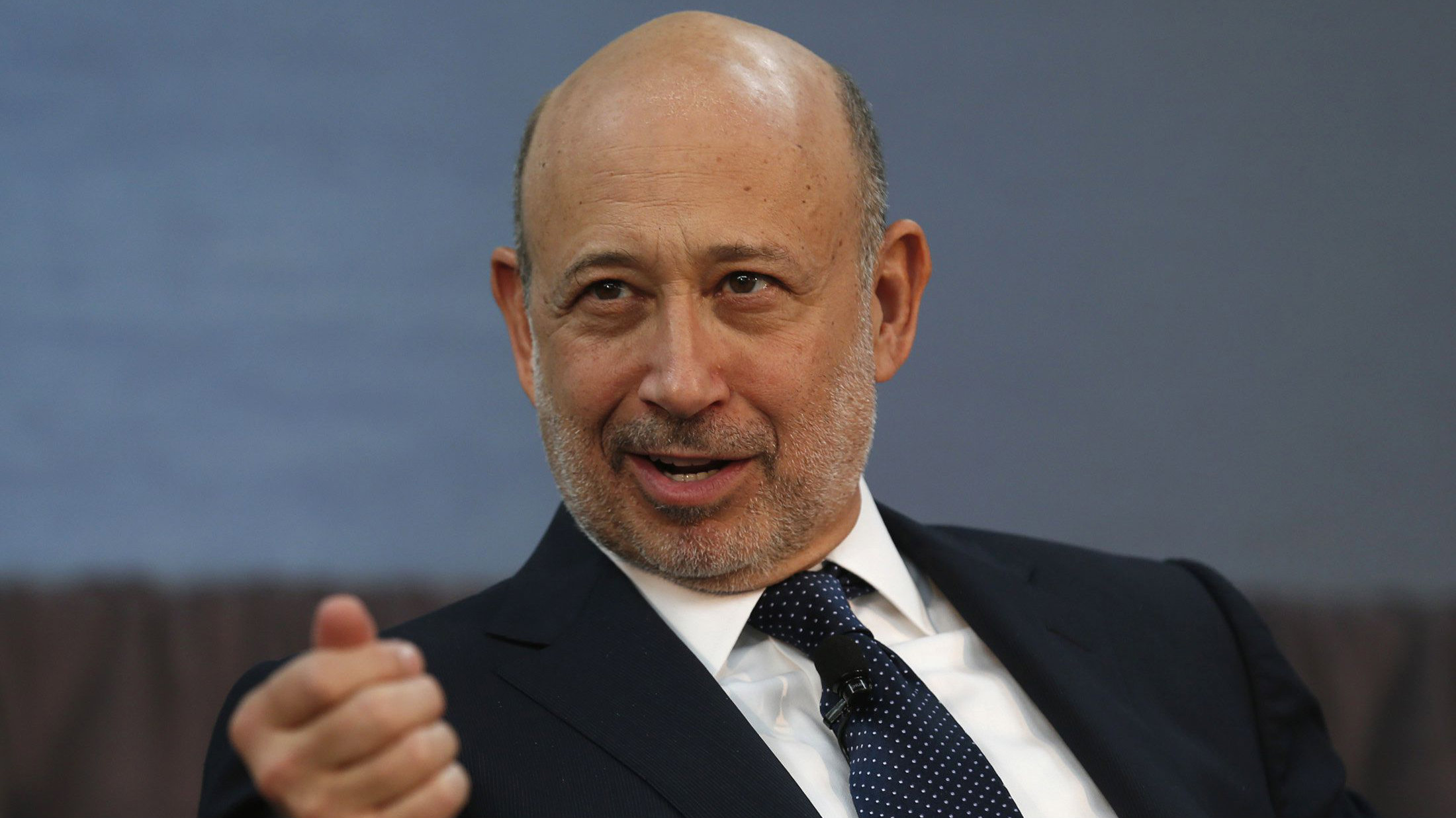 Goldman Sachs CEO Lloyd Blankfein takes part in a panel discussion following a news conference announcing a $20 million partnership to bring Goldman Sachs' 10,000 Small Businesses initiative to the city of Detroit, Michigan November 26, 2013. REUTERS/Rebecca Cook (UNITED STATES - Tags: BUSINESS EMPLOYMENT)