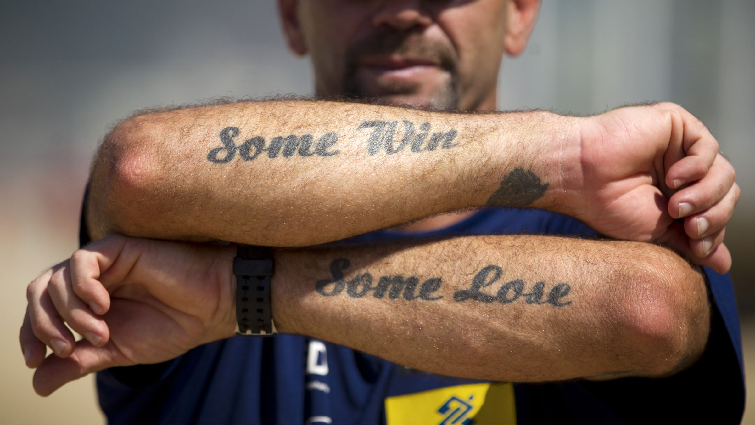 In this April 4, 2012 photo, beach volleyball trainer Abel Martinez shows his tattoos on Ipanema beach in Rio de Janeiro, Brazil. Martinez trains athletes Talita Antunes and Maria Elisa Antonelli, one of the favorite teams to compete at the London 2012 Olympic games women's beach volley event.