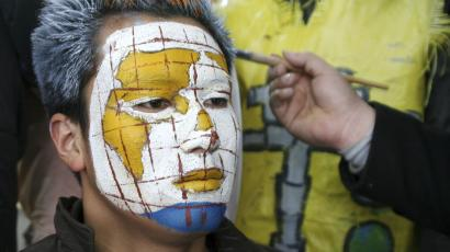 Man with map painted on his face