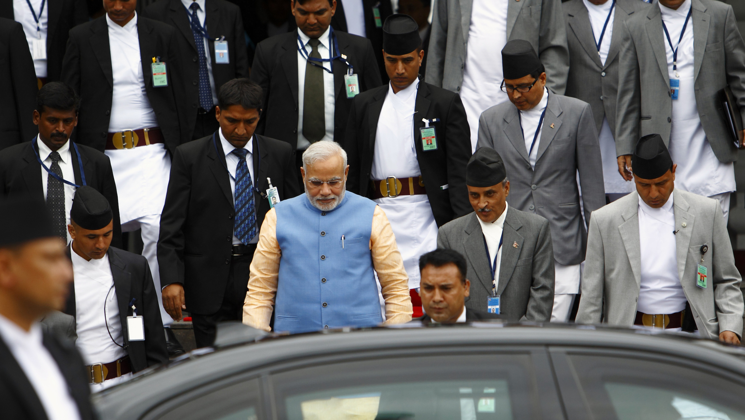 India's Prime Minister Narendra Modi (in blue) leaves after meeting with Nepal's Prime Minister Sushil Koirala.