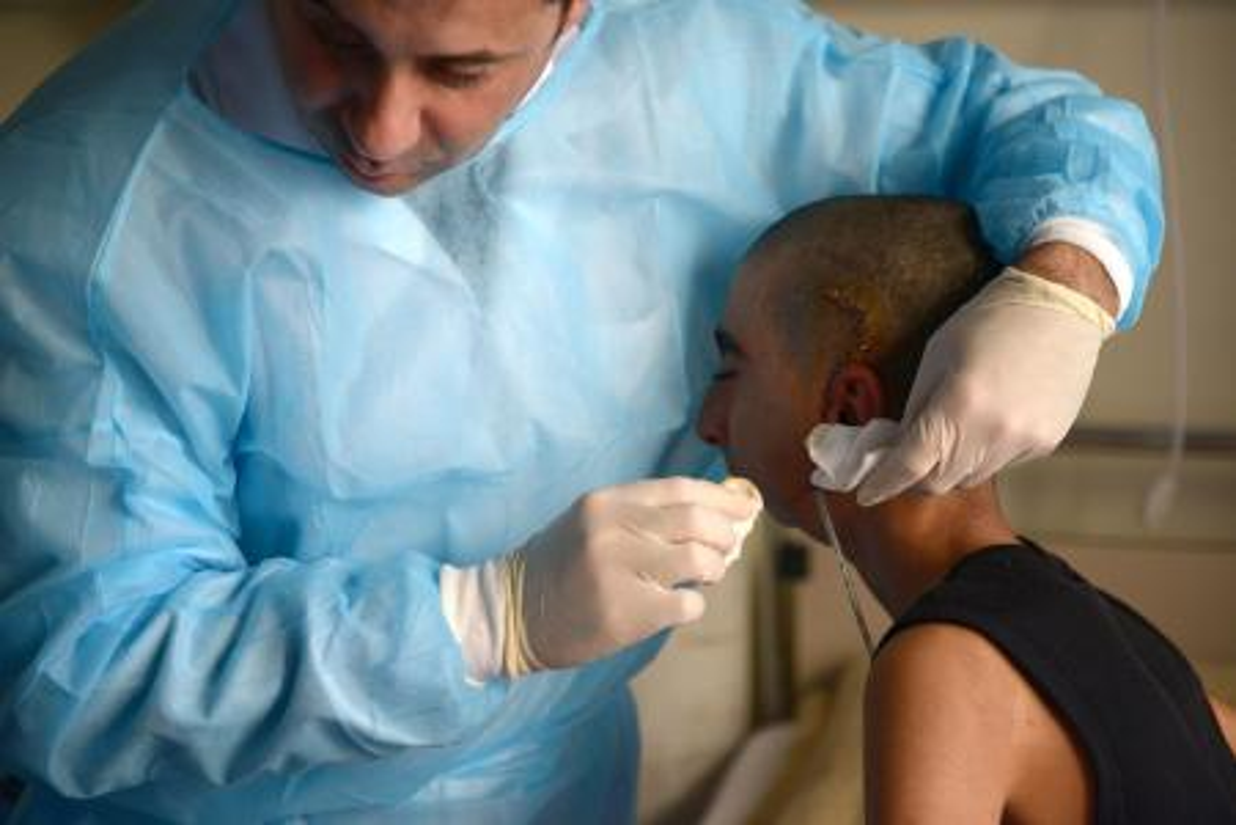 Surgeon and Iraqi boy with jaw injury