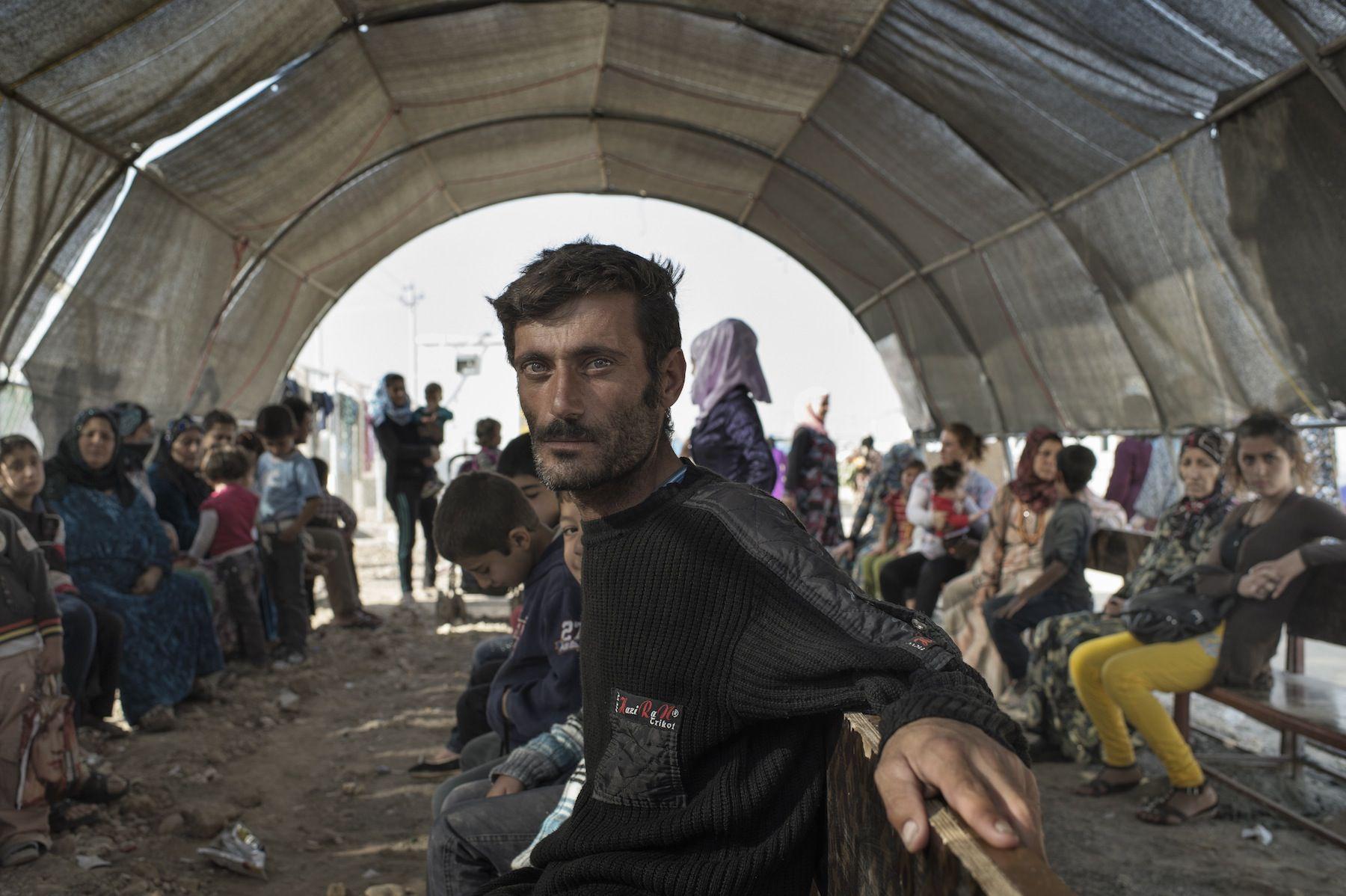 People waiting at Domiz refugee camp