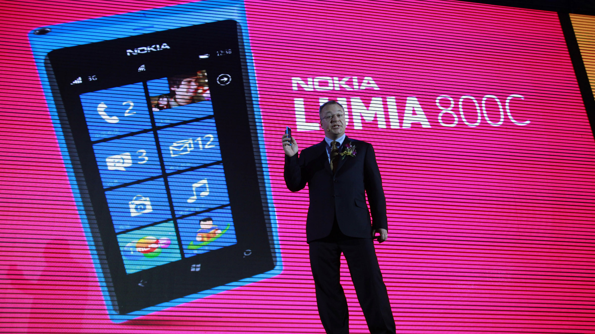Nokia CEO Stephen Elop announces the launch of the company's new Lumia 800C smartphone in Beijing, China, Wednesday, March 28, 2012. Struggling cellphone maker Nokia launched its first smartphone design for China on Wednesday, looking to the world's biggest mobile market to help drive a turnaround.(AP Photo/Ng Han Guan)