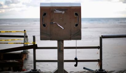 A damaged pay phone is seen on a boardwalk in the Rockaways section, in the Queens borough of New York November 24, 2012. REUTERS/Eric Thayer (UNITED STATES - Tags: DISASTER SOCIETY BUSINESS TELECOMS) - RTR3AUAX