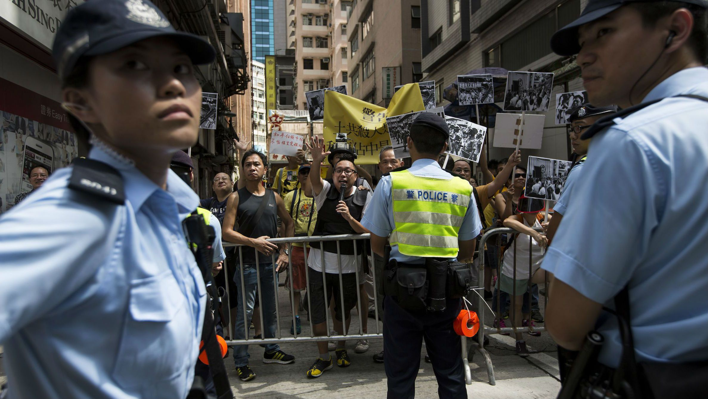 Occupy Central supporters shout to pro-Beijing protesters as they march in the streets to demonstrate against a pro-democracy Occupy Central campaign in Hong Kong August 17, 2014.