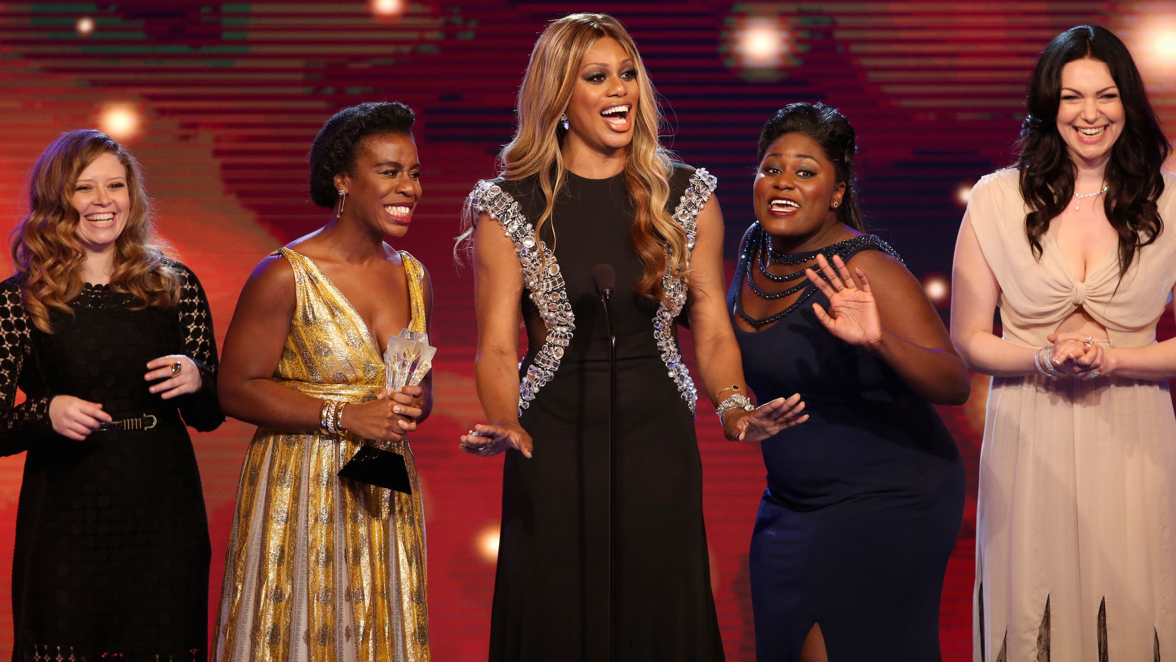 """From left, Natasha Lyonne, Uzo Aduba, Laverne Cox, Danielle Brooks, and Laura Prepon accept the award for best comedy series for """"Orange is the New Black"""" at the Critics' Choice Television Awards at the Beverly Hilton Hotel on Thursday, June 19, 2014, in Beverly Hills, Calif. (Photo by Paul A. Hebert/Invision/AP)"""