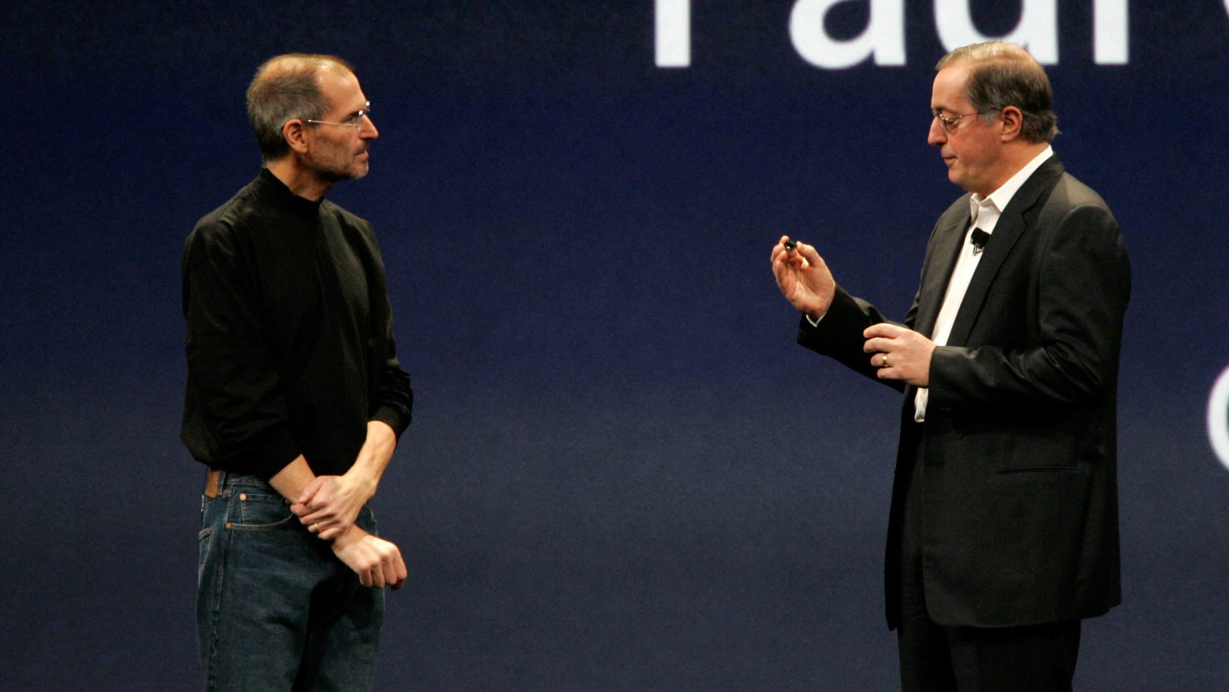 Apple CEO Steve Jobs, left, talks to CEO of Intel Paul Otellini during the keynote address at Apple MacWorld Conference in San Francisco, Tuesday, Jan. 15, 2008. (AP Photo/Jeff Chiu)