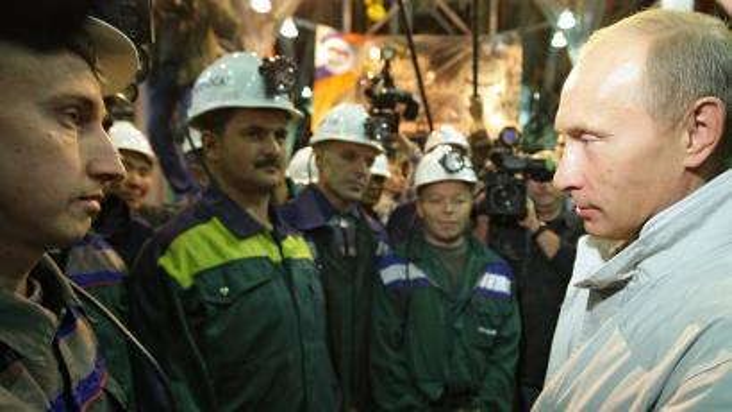 Vladimir Putin talks to mine workers in the city of Mirny in Eastern Siberia.