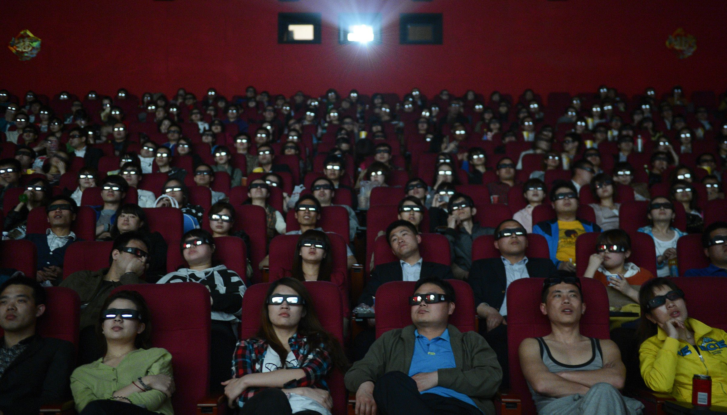 """People wearing 3D glasses watch the film """"Titanic 3D"""" at a movie theatre in Taiyuan, Shanxi province April 10, 2012. Titanic 3D began showing in Chinese cinemas on Tuesday. REUTERS/Stringer (CHINA - Tags: ENTERTAINMENT SOCIETY) CHINA OUT. NO COMMERCIAL OR EDITORIAL SALES IN CHINA"""