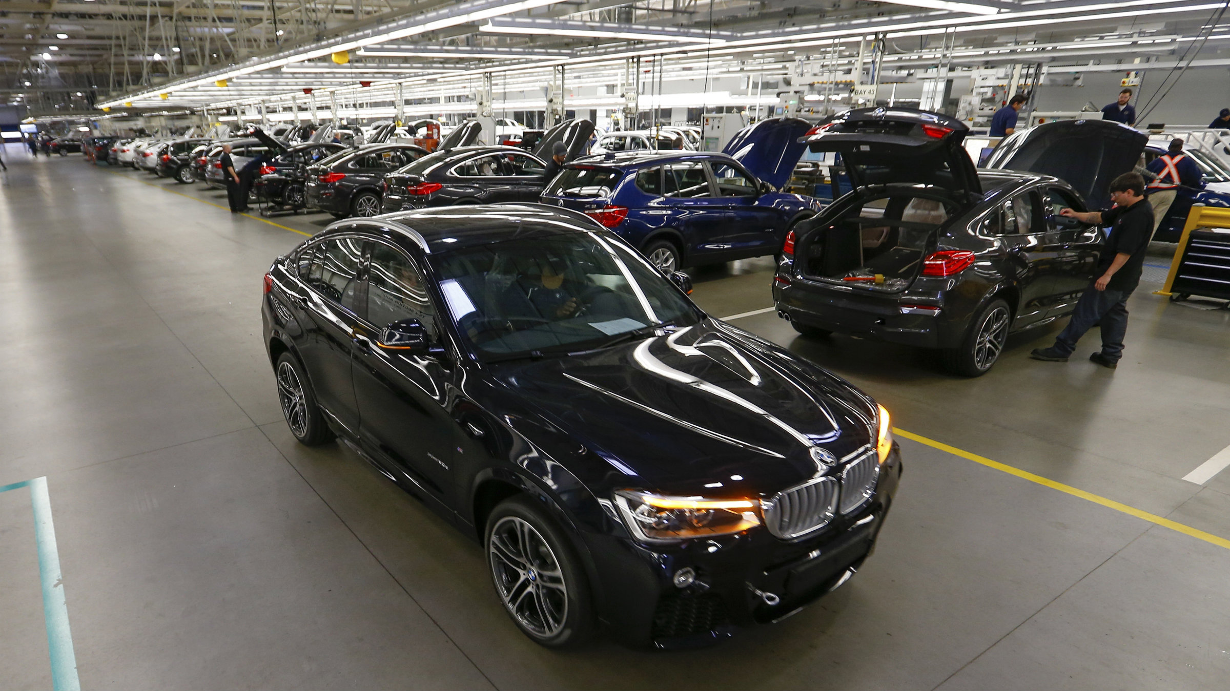 A finished BMW X4 is driven off the production line at the BMW manufacturing plant in Spartanburg, South Carolina.