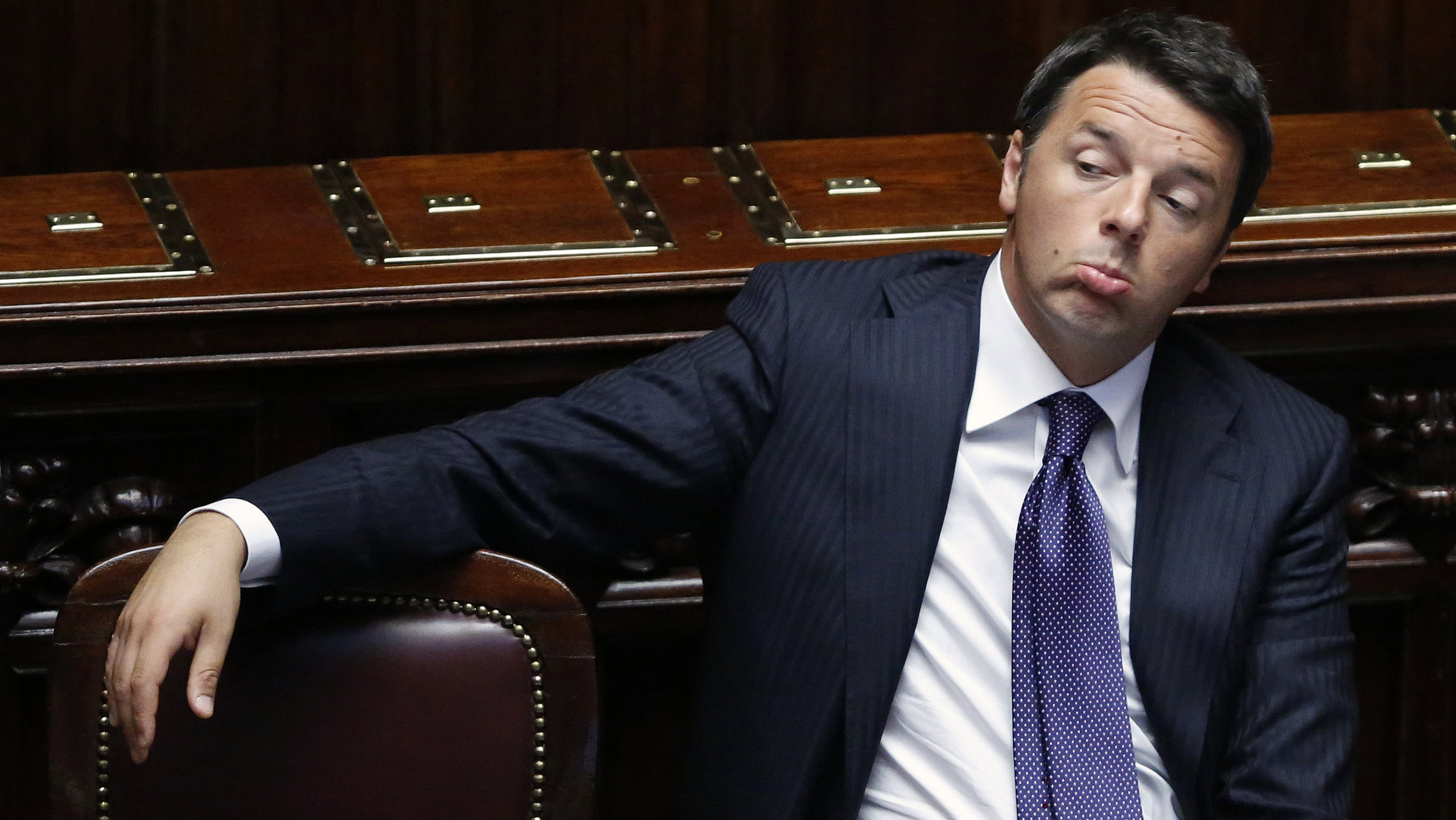 Italy's Prime Minister Matteo Renzi sits after delivering his speech at the Italian Parliament in Rome.