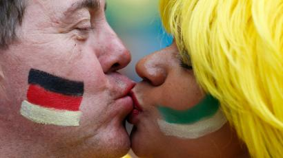 A couple kiss as they wait for the start of the 2014 World Cup semi-finals between Brazil and Germany at the Mineirao stadium in Belo Horizonte July 8, 2014.