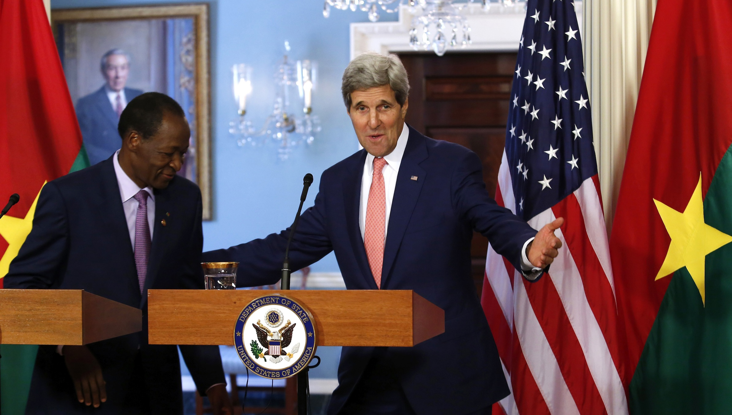 U.S. Secretary of State John Kerry (R) meets with Burkina Faso President Blaise Compaore at the State Department in Washington, August 4, 2014. REUTERS/Yuri Gripas (UNITED STATES - Tags: POLITICS) - RTR417Q3