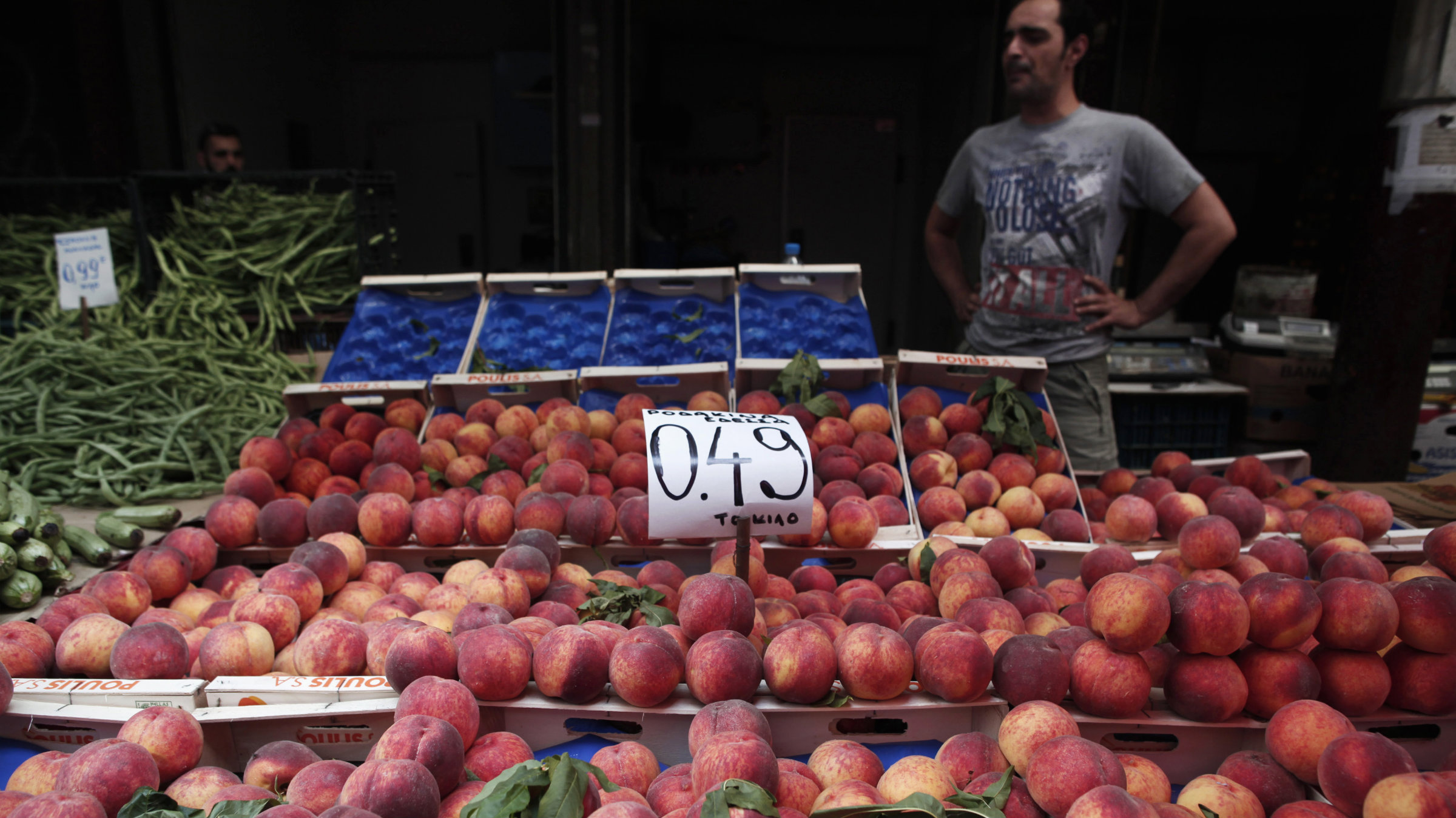 Peaches are displayed on a fruit vendor's stall at a grocery market in Athens.