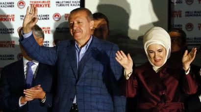 Turkey's Prime Minister Tayyip Erdogan celebrates his election victory next to wife Ermine in front of the party headquarters in Ankara August 10, 2014.