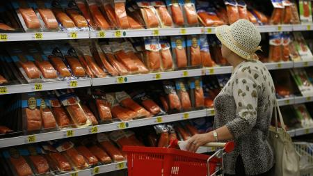 A customer visits the seafood department of an Auchan grocery store in Moscow, August 18, 2014