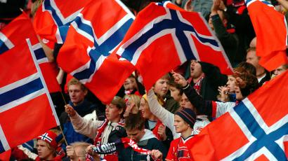 Norwegian soccer fans celebrate in the stands of a World Cup qualifier match.