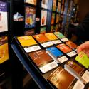 A customer selects coffee packets at the newly opened Keurig retail store Burlington, Massachusetts November 8, 2013. REUTERS/Brian Snyder (UNITED STATES - Tags: BUSINESS) - RTX155JC