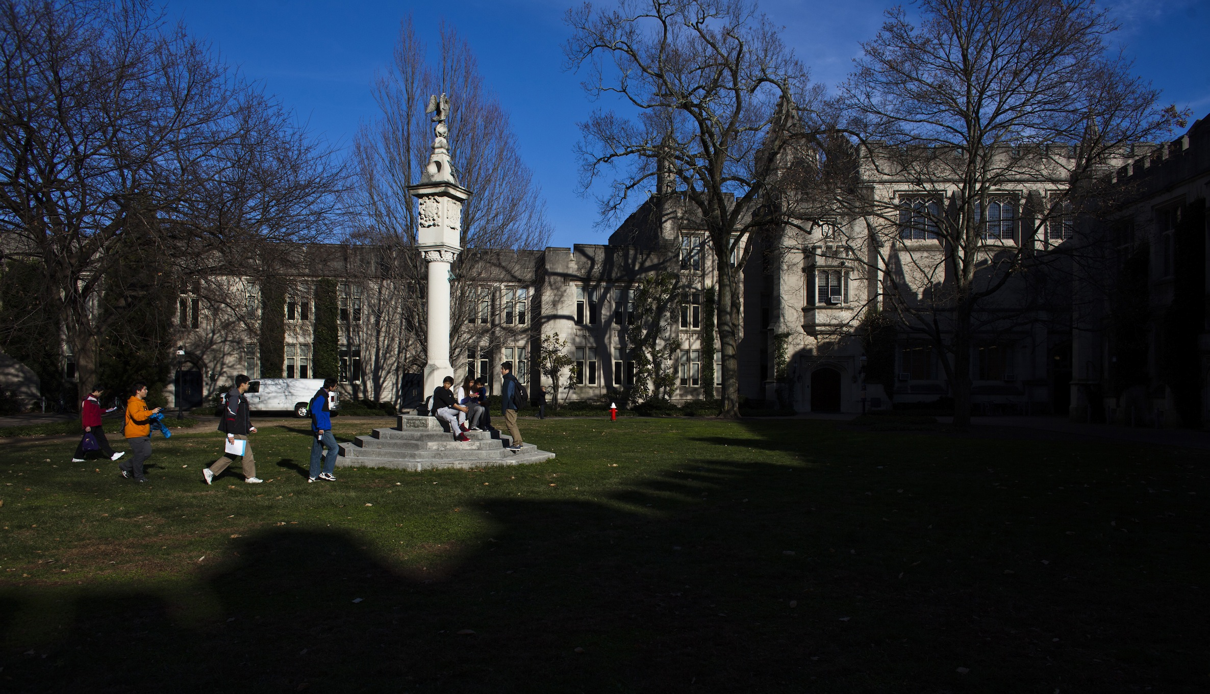 People walk around the Princeton University campus in New Jersey, November 16, 2013. A meningitis vaccine approved for use in Europe and Australia but not in the United States can be imported to try to stop an outbreak of the disease at Princeton University in New Jersey, federal health officials said. The Food and Drug Administration agreed this week to the importation of the vaccine, Bexsero, for potential use on the Ivy League campus, Barbara Reynolds, a spokeswoman for the Centers for Disease Control and Prevention, said on Saturday. REUTERS/Eduardo Munoz (UNITED STATES - Tags: SOCIETY EDUCATION HEALTH) - RTX15GEN