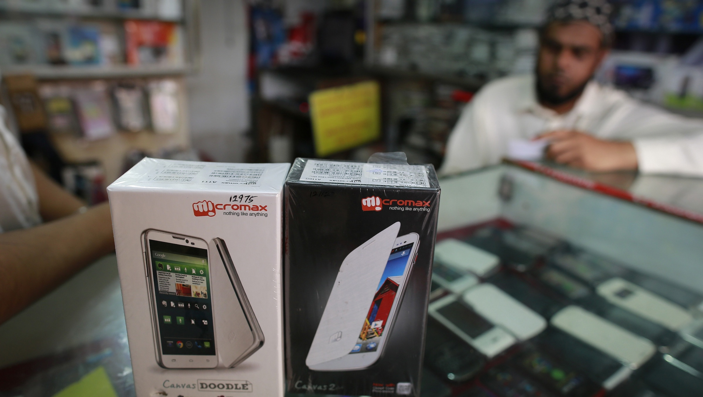 Micromax mobile phones are displayed at a mobile store in Mumbai December 4, 2013. India's Micromax, which has become the country's No. 2 smartphone brand just five years after selling its first handset - a $30 made-in-China model - is looking to go upmarket and overseas. The unlisted company sold 6.8 million phones in the July-September quarter including 2.2 million smartphones, and is on track to surpass $1 billion in sales in the fiscal year ending in March. Picture taken December 4, 2013. REUTERS/Danish Siddiqui (INDIA - Tags: BUSINESS TELECOMS) - RTX16FSW
