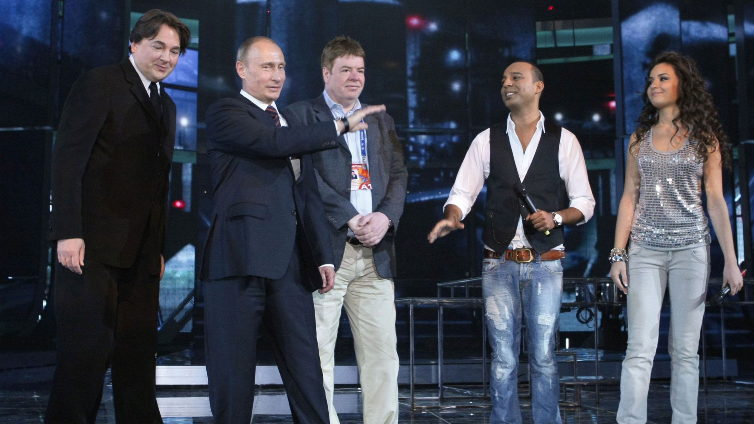 Russia's Prime Minister Vladimir Putin (2nd L) speaks next to director of the First Television Channel Konstantin Ernst (L) during Putin's visit to the Olympic Stadium in Moscow May 10, 2009. The stadium hosts the Eurovision Song Contest.