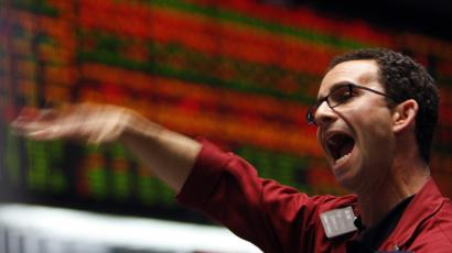 A trader in the S&P 500 pit at the Chicago Board of Trade signal orders shortly before the closing bell.