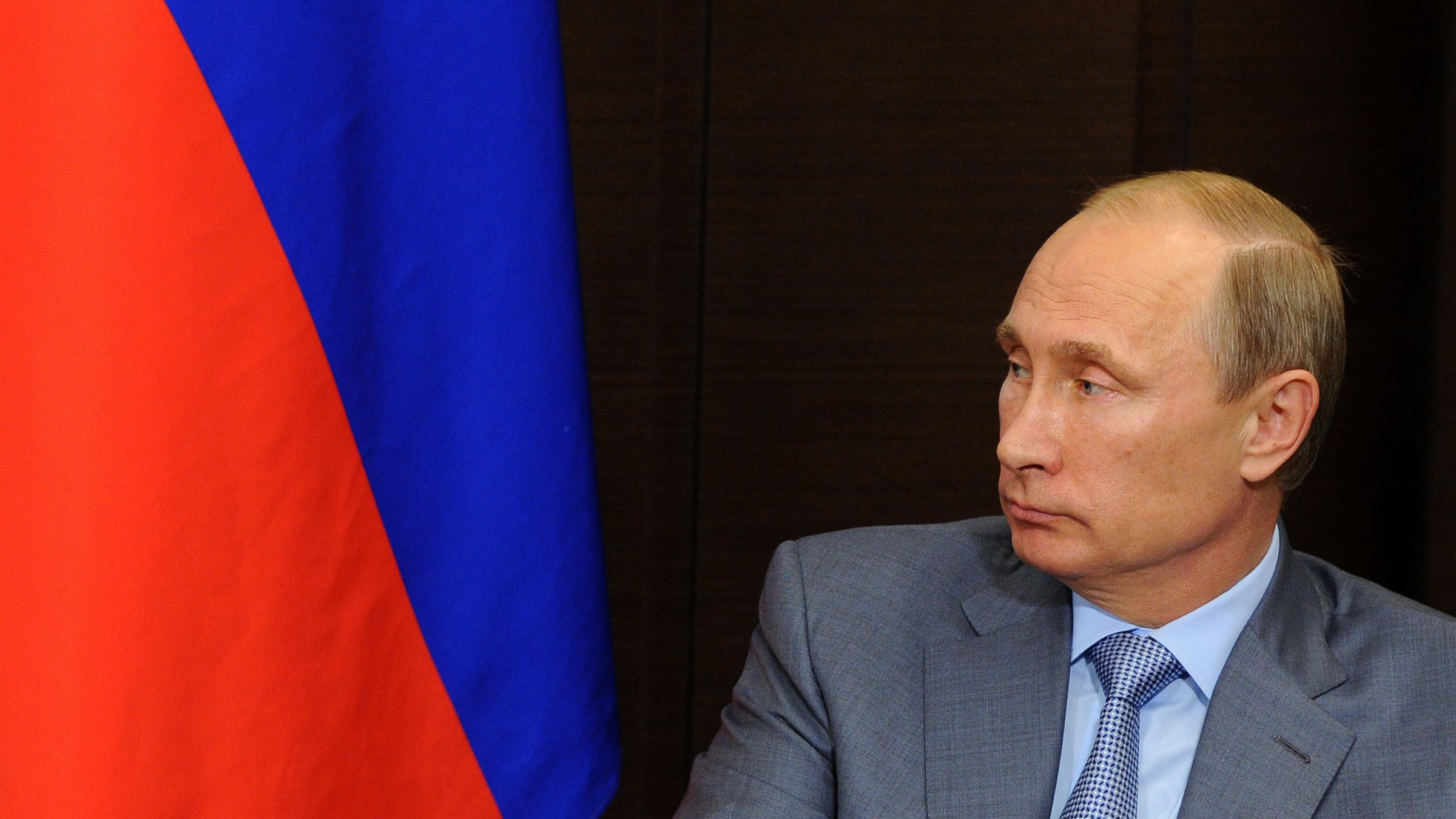 Russian President Vladimir Putin listens to Finnish President Sauli Niinisto prior to their talks at a residence at the Black Sea resort of Sochi, southern Russia, Friday, Aug. 15, 2014. Putin met with his Finnish counterpart to discuss interaction between the two countries, as well as international problems, first of all, the situation in Ukraine, the Kremlin press service reported. (AP Photo/RIA-Novosti, Mikhail Klimentyev, Presidential Press Service)