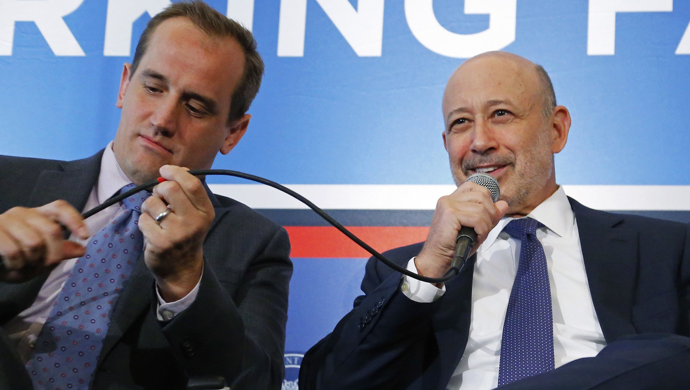 Shake Shack CEO Garutti and Goldman Sachs Group, Inc. Chairman and CEO Blankfein participate in a panel discussion during the White House Summit on Working Families in Washington