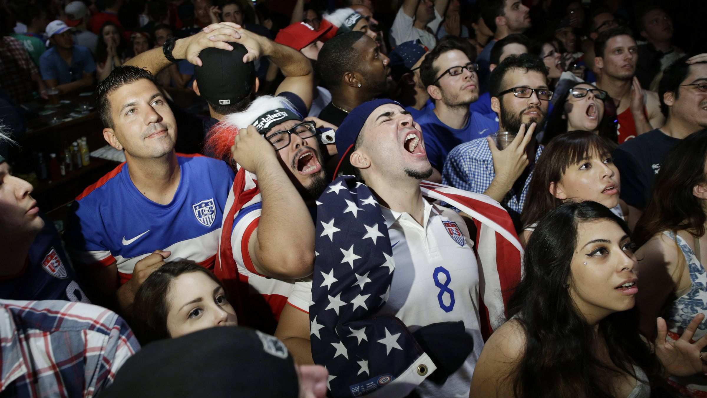 U.S. soccer fans react as they watch their team miss a goal against Belgium during a watch party at the Crown & Anchor British Pub Tuesday, July 1, 2014 in Las Vegas.