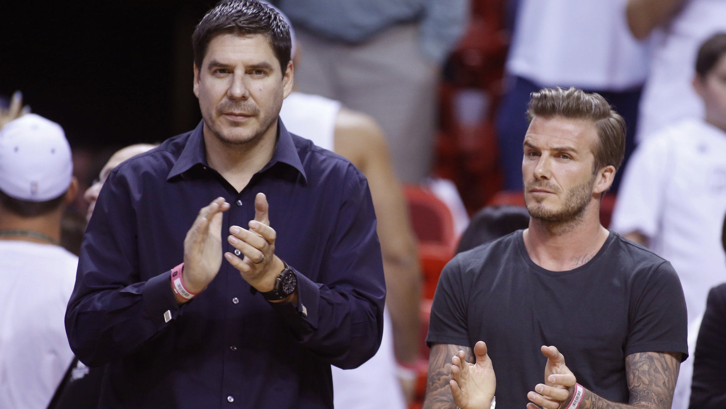 Former soccer player David Beckham (R) and Marcelo Claure, CEO of Brightstar applaud before Game 5 of the NBA Eastern Conference final