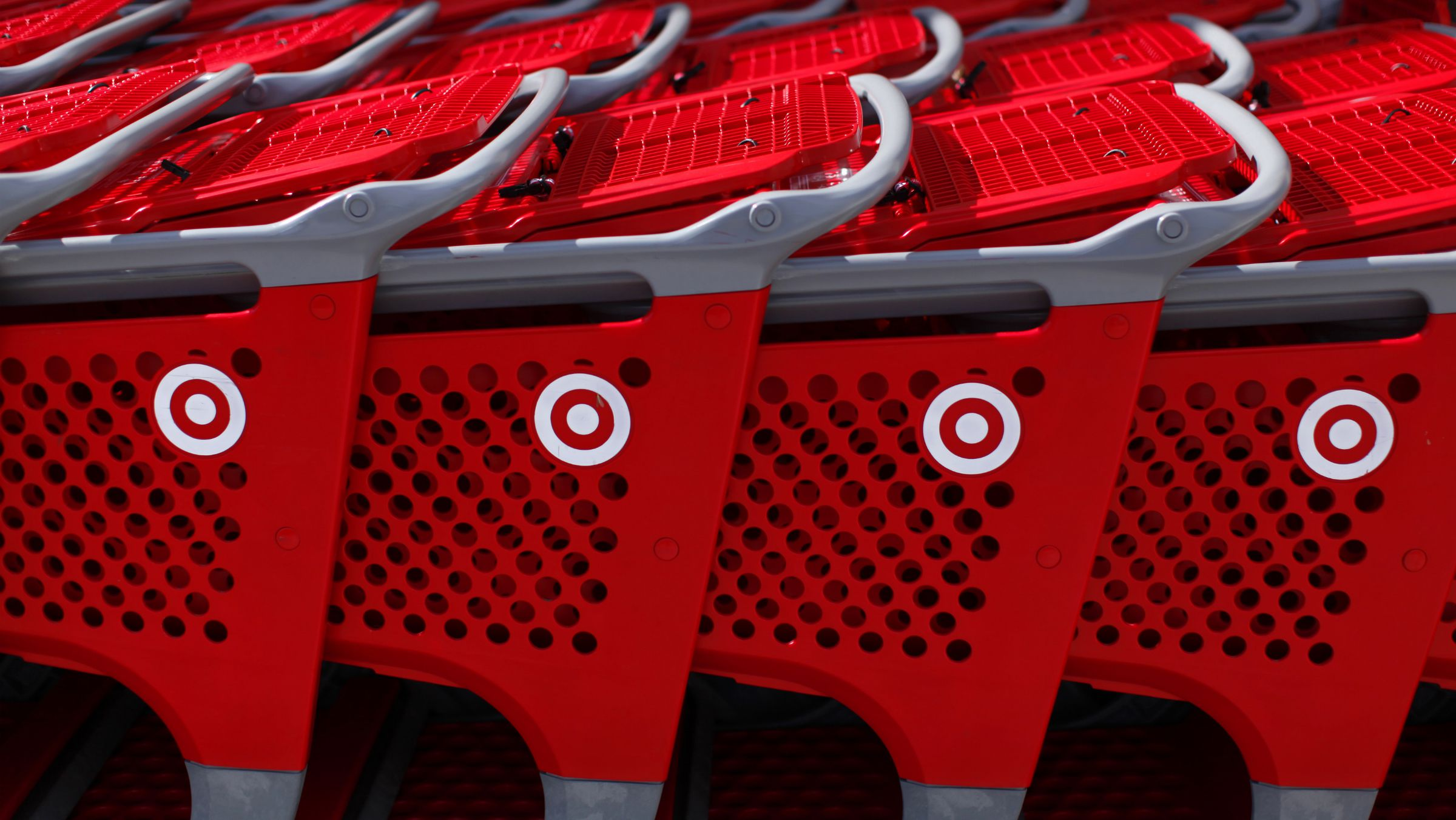 Target shopping carts await customers outside a Target department store in Encinitas, California February 21, 2012. Target will report earnings this week. REUTERS/Mike Blake (UNITED STATES - Tags: BUSINESS)