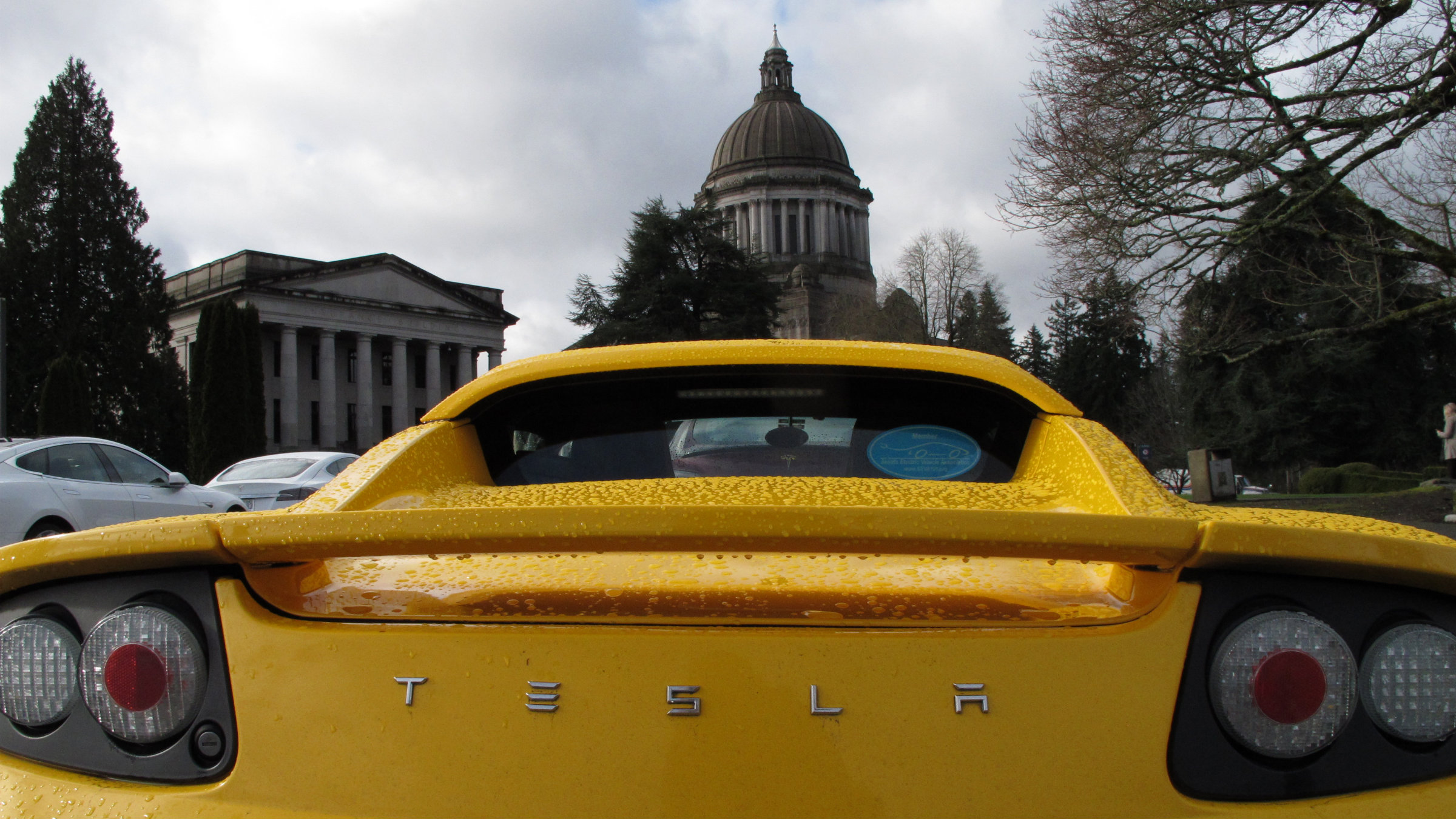 A Tesla car is parked near the Washington state Capitol on Monday, Feb. 17, 2014, in Olympia, Wash. The electric car company, which has sales and service operations in Seattle and Bellevue, held a rally to protest measures being considered by the Legislature that would prevent it from opening additional facilities in the state. (AP Photo/Rachel La Corte