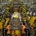 Robotic arms spot welds on the chassis of a Ford Transit Van under assembly at the Ford Claycomo Assembly Plant in Claycomo, Missouri April 30, 2014. REUTERS/Dave Kaup (UNITED STATES - Tags: BUSINESS TRANSPORT)