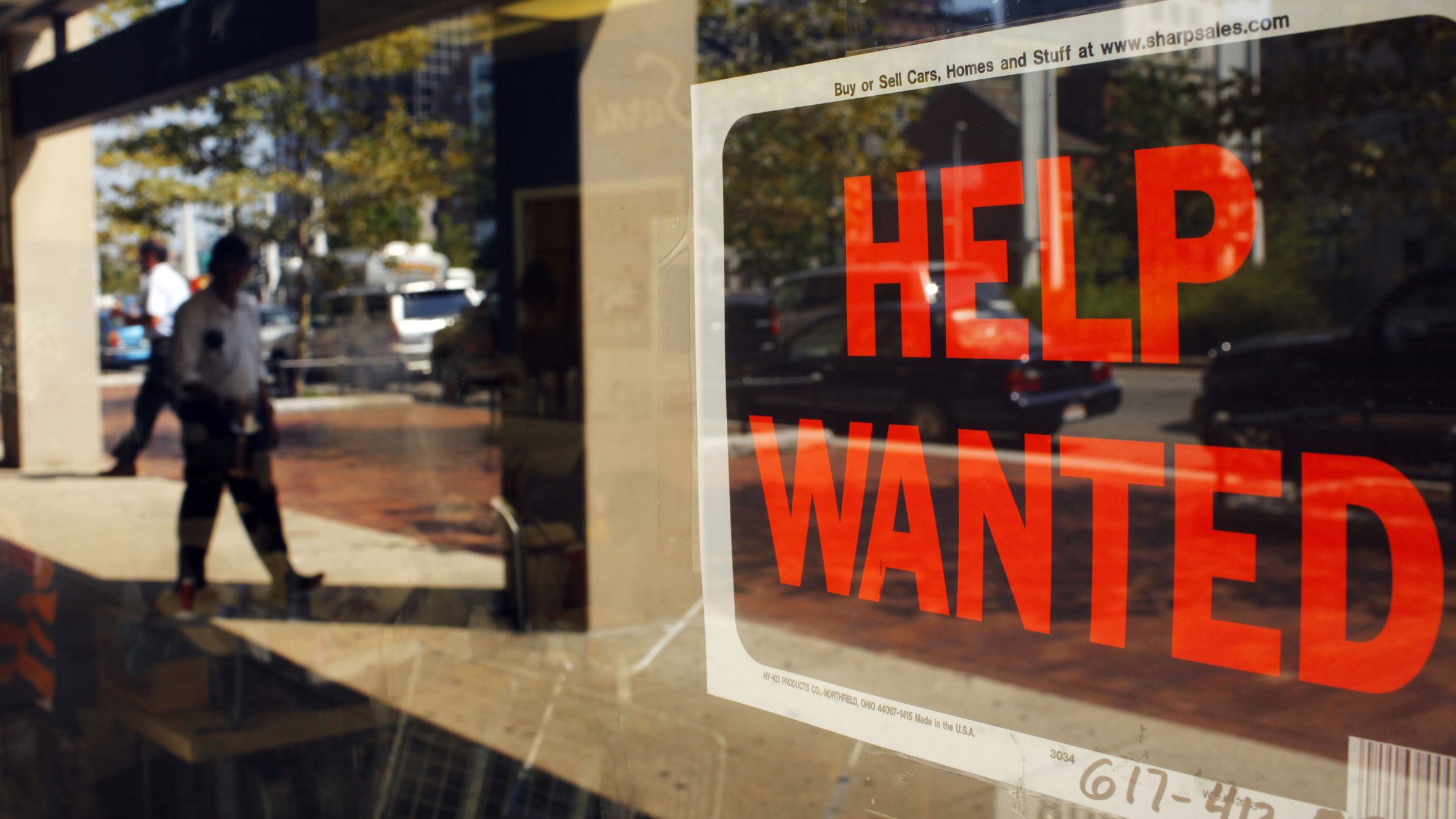"""A """"Help Wanted"""" sign in the window advertises a job opening at a dry cleaners in Boston, Massachusetts September 1, 2010. REUTERS/Brian Snyder (UNITED STATES - Tags: BUSINESS EMPLOYMENT)"""