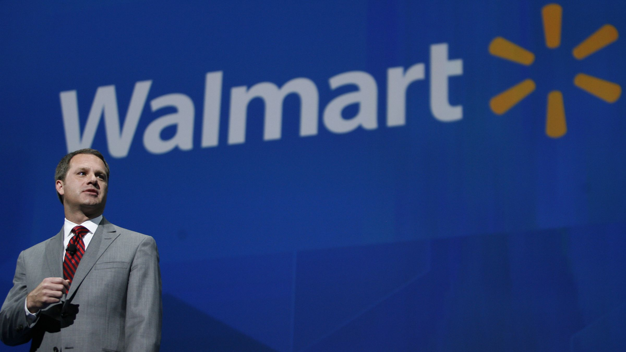 In this June 7, 2013 file photo, Doug McMillon, President and CEO, Wal-Mart International, speaks at the shareholders meeting in Fayetteville, Ark. Wal-Mart Stores on Monday, Nov. 25, 2013 announced that CEO and President Mike Duke is stepping down from those posts, and named McMillon as his successor, effective Feb. 1, 2014.