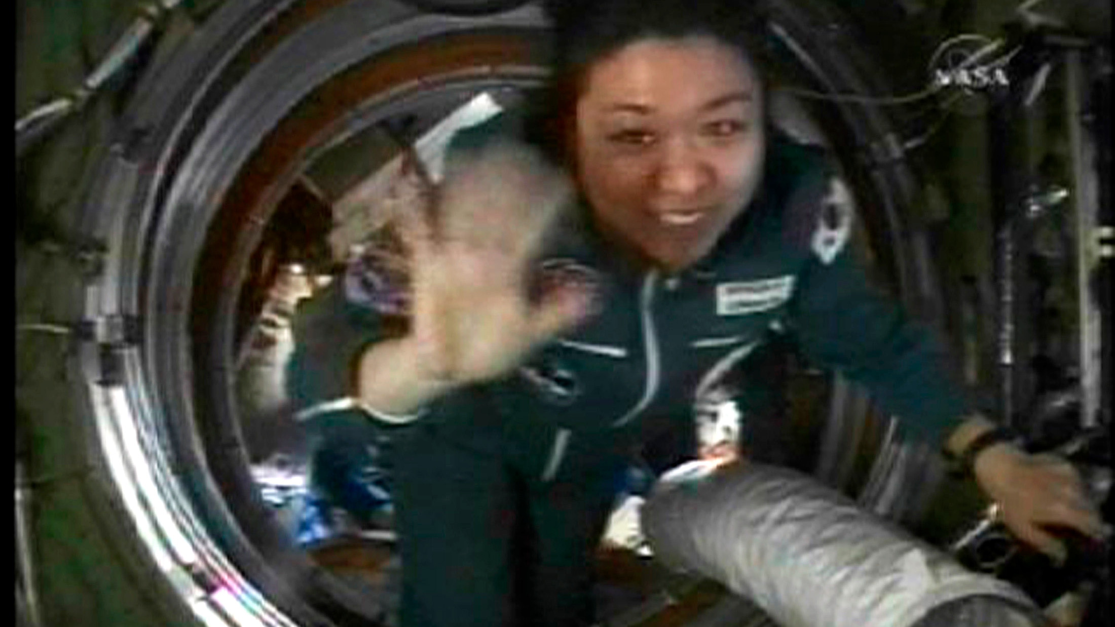 Spaceflight participant So-yeon Yi of Korea enters the International Space Station in this image from NASA TV April 10, 2008. Spaceflight participant Yi will return to Earth April 19th with Expedition 16 crew members, Commander Peggy Whitson and Flight Engineer Yuri Malenchenko.