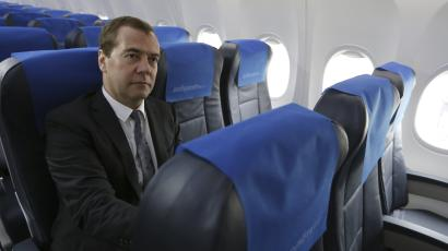 Russian prime minister Dmitry Medvedev, aboard a Boeing owned by Dobrolet, a discount affiliate of Aeroflot, in June 2014.