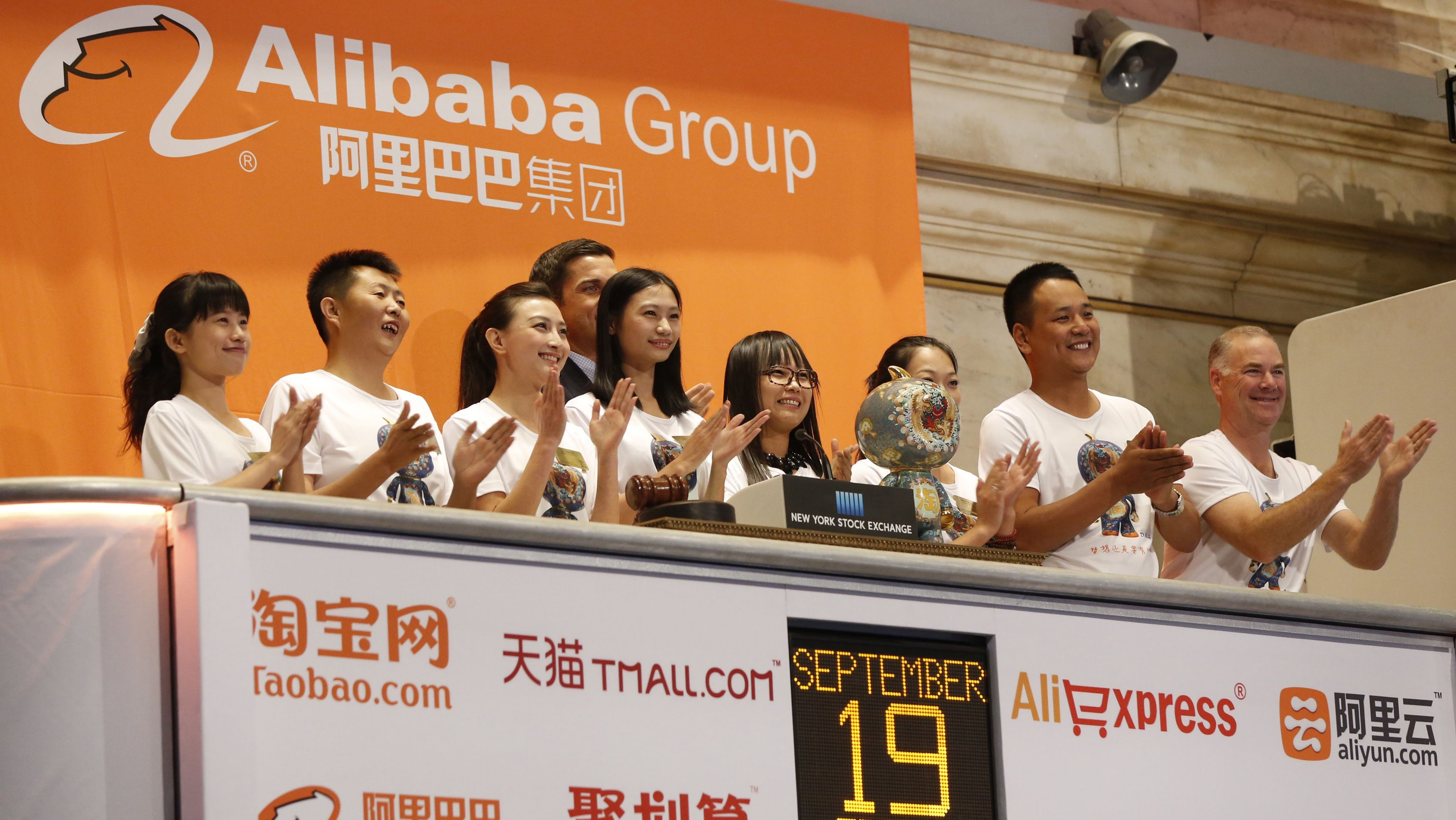"""Alibaba employees applaud as the opening bell of the New York Stock Exchange is rung, before the initial public offering (IPO) of Alibaba Group Holding Ltd under the ticker """"BABA"""" in New York September 19, 2014. REUTERS/Lucas Jackson"""