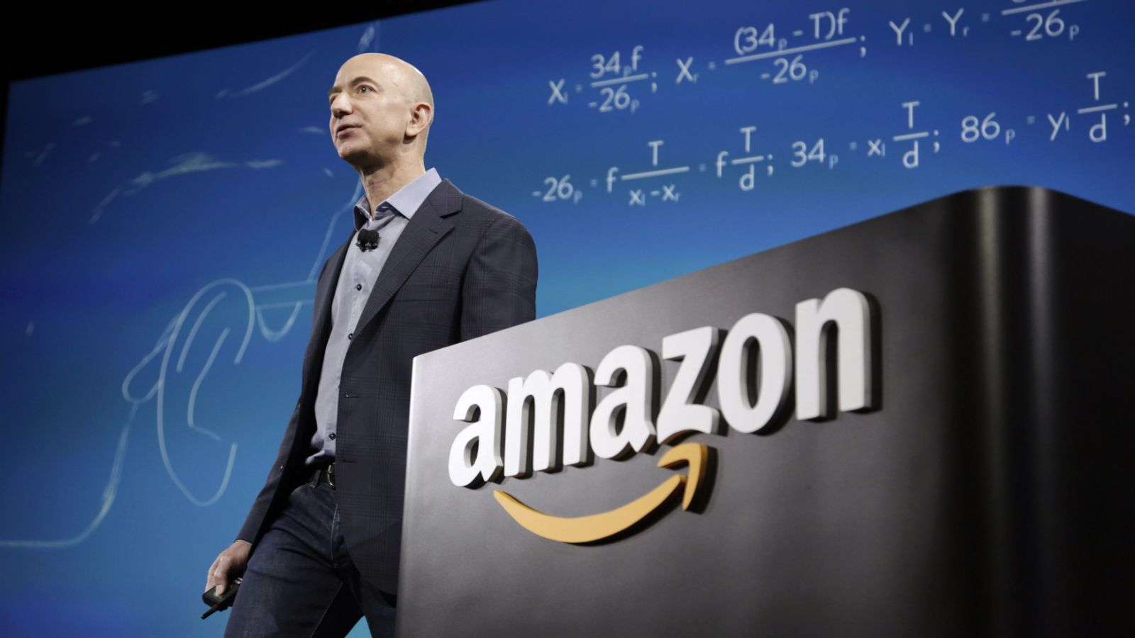 """Amazon CEO Jeff Bezos discusses his company's new Fire smartphone at a news conference in Seattle, Washington June 18, 2014. Bezos unveiled a $200 """"Fire"""" smartphone on Wednesday equipped with a 3D-capable screen and an ability to recognize music and TV shows, hoping to stand out in a crowded field dominated by Apple Inc and Samsung Electronics."""