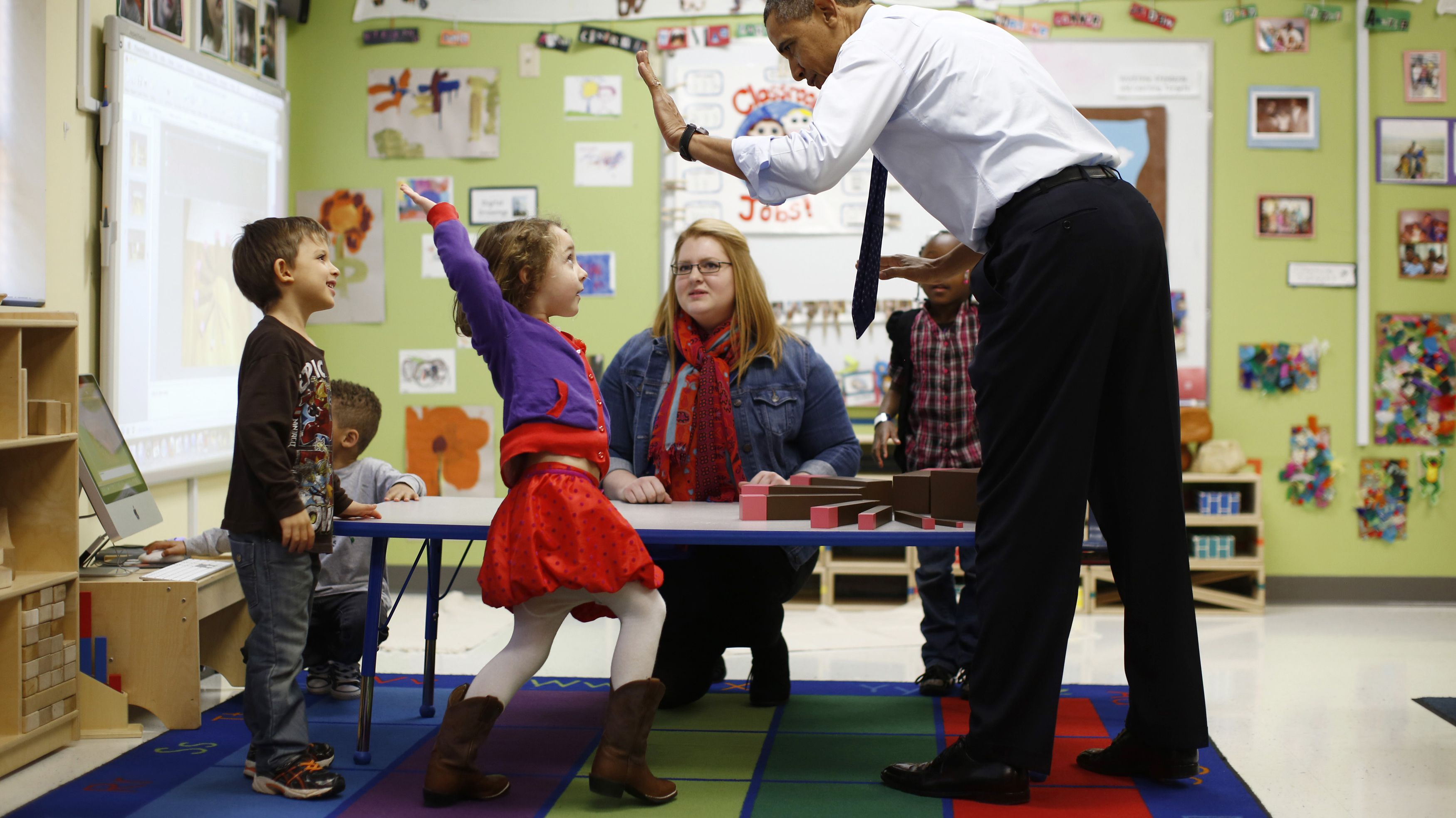 english korean chinese japanese math counting arithmetic achievement performance studying students children kids U.S. President Barack Obama high-fives children in a pre-kindergarten classroom at College Heights early childhood learning center in Decatur February 14, 2013. Obama flew to Georgia to push his plan to ensure high-quality preschool, unveiled during his State of the Union address this week. REUTERS/Jason Reed