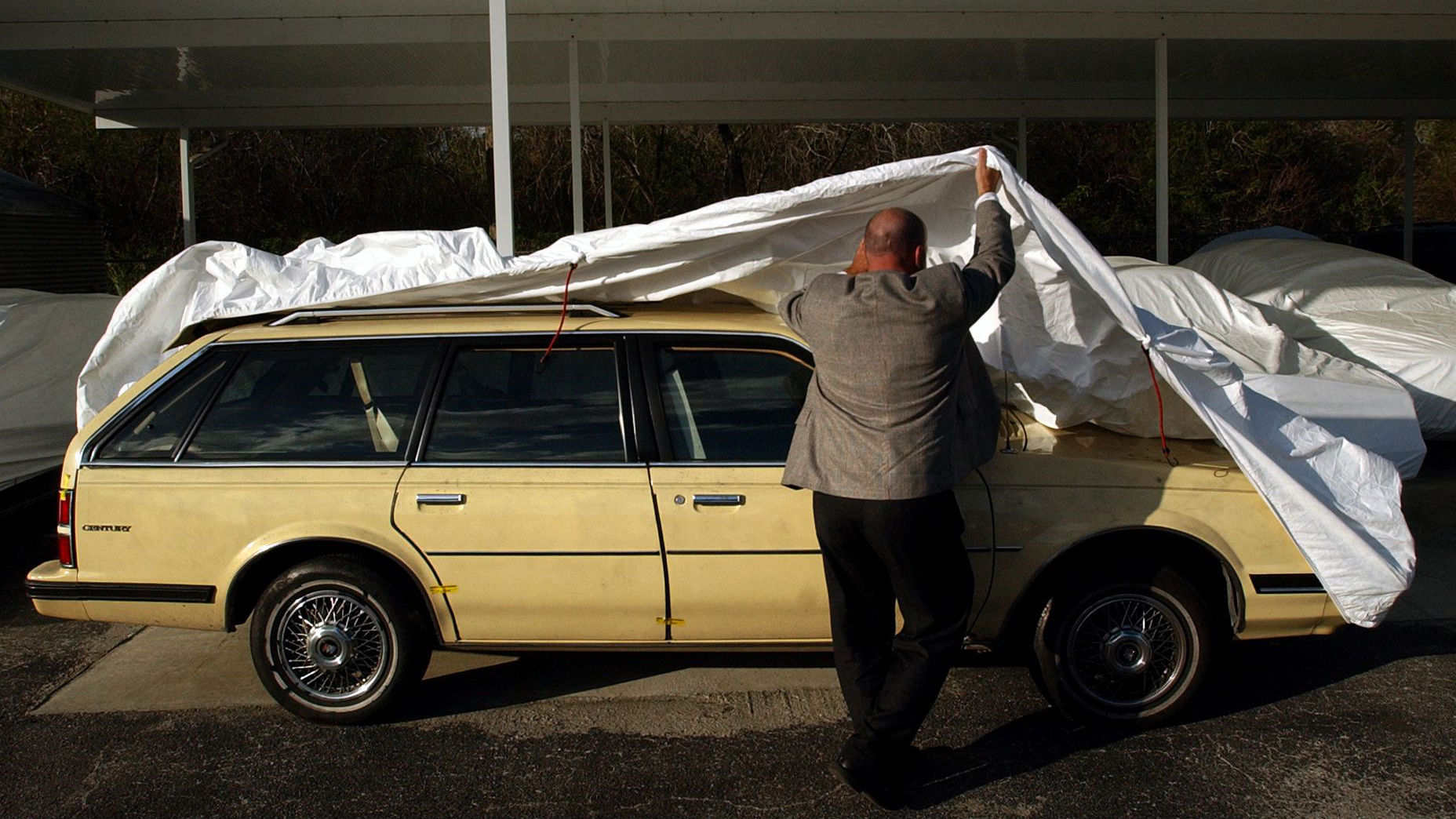 Sarasota County Sheriff Capt. Jeffrey Bell reveals the 1992 Buick Century station wagon they say was used in the abduction of Carlie Brucia at one of their fleet facilities in Osprey, Fla., Thursday, Feb. 5, 2004. The Sarasota County Sheriff's office is pleading with the public for assistance surrounding the abduction of the 11-year-old Brucia Sunday night. (AP Photo/Chip Litherland, POOL)