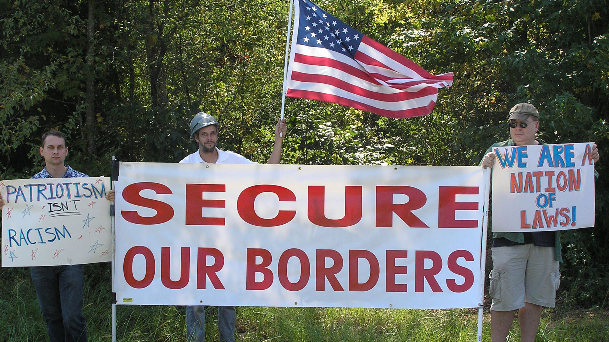 Unidentified members of the Minuteman Civil Defense Corps stage a demonstration outside a prison that houses undocumented aliens facing deportation near Butler, Georgia.