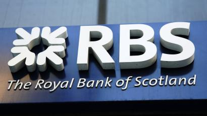 A sign of Royal Bank of Scotland (RBS) at a branch in central London.