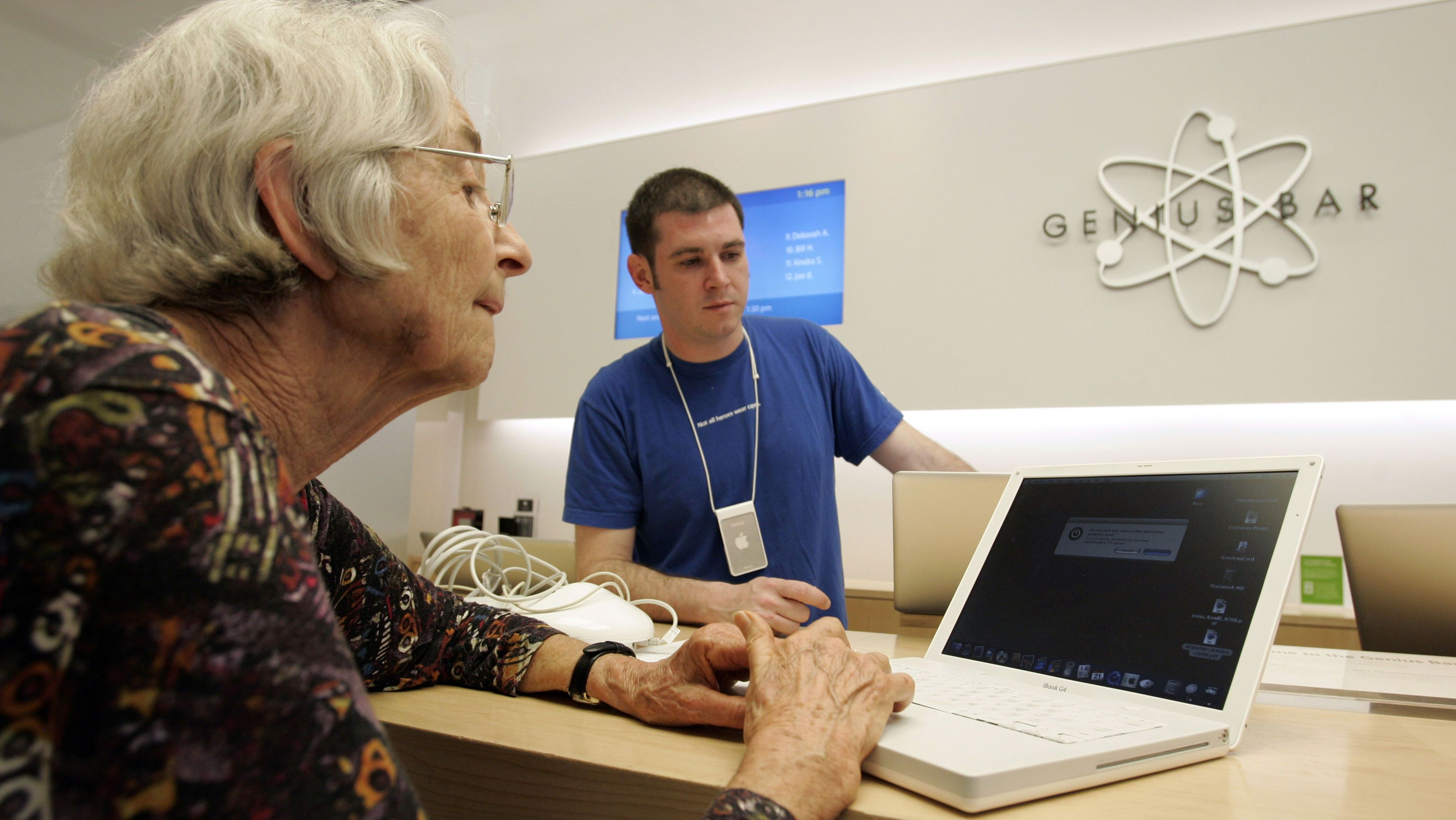 In this April 21, 2009 photo, a customer enlists the help of a store employee at the Genius Bar at an Apple store in Palo Alto, Calif. Apple Inc. says its profit jumped 15 percent in the last quarter, well ahead of Wall Street's expectations despite the global economic downturn. (AP Photo/Paul Sakuma)
