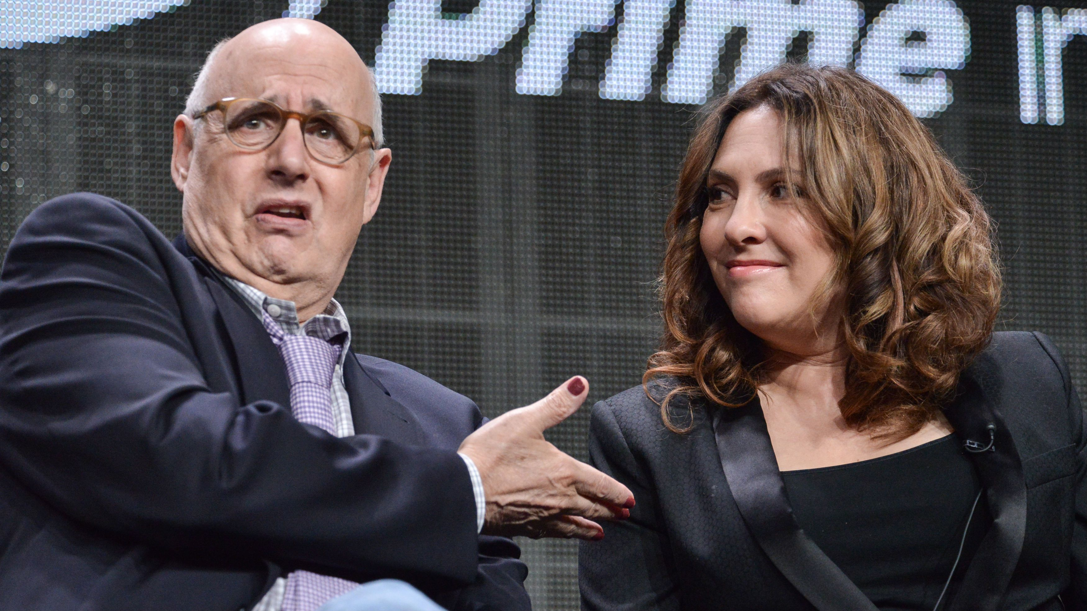 """Jeffrey Tambor, left, and Jill Soloway speak onstage during the """"Transparent"""" panel at the Amazon 2014 Summer TCA on Saturday, July 12, 2014, in Beverly Hills, Calif. (Photo by Richard Shotwell/Invision/AP)"""