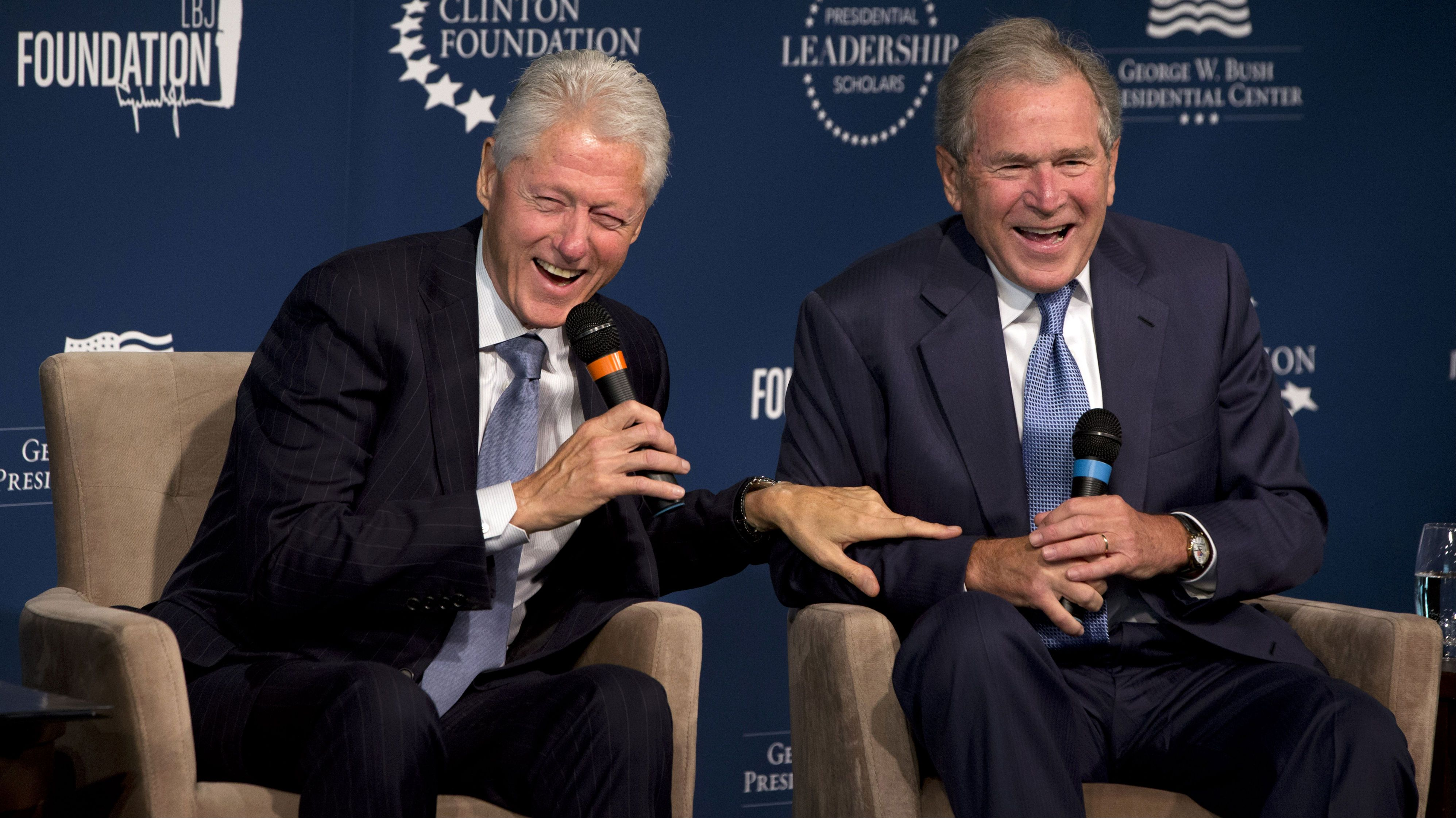 Former Presidents Bill Clinton, left, and George W. Bush, laugh while participating in the Presidential Leadership Scholars Program Launch, Monday, Sept. 8, 2014, at The Newseum in Washington. The two are launching a new scholars program at four presidential libraries, aiming to help academics and business leaders learn more about presidential leadership. (AP Photo/Jacquelyn Martin)