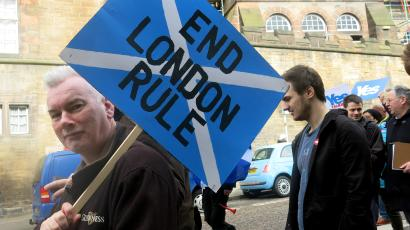 A demonstrator carries a sign during a pro-independence march in Edinburgh, Scotland.