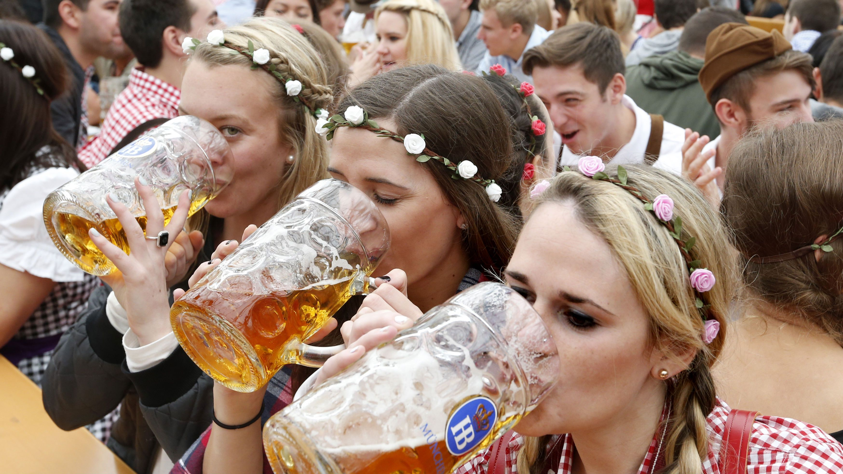 Visitors enjoy beer during their visit to the 181st Oktoberfest in Munich September 28, 2014. Millions of beer drinkers from around the world will come to the Bavarian capital for the Oktoberfest, which runs until October 5.