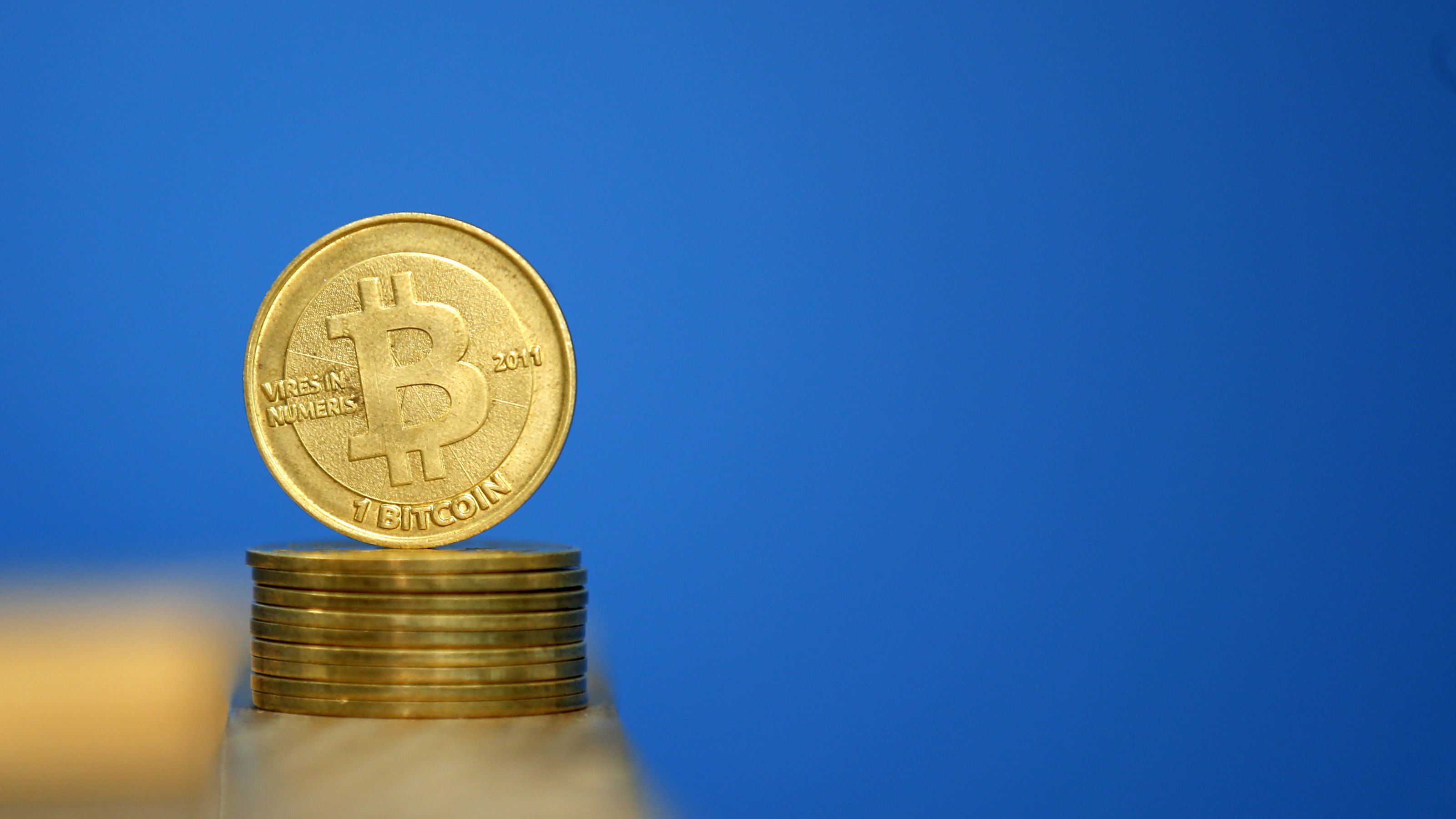 Bitcoin (virtual currency) coins are seen in an illustration picture taken at La Maison du Bitcoin in Paris July 11, 2014. French police dismantled an illegal Bitcoin exchange and seized 388 virtual currency units worth some 200,000 euros ($272,800) in the first such operation in Europe a public prosecutor said on Monday. REUTERS/Benoit Tessier (FRANCE - Tags: BUSINESS)