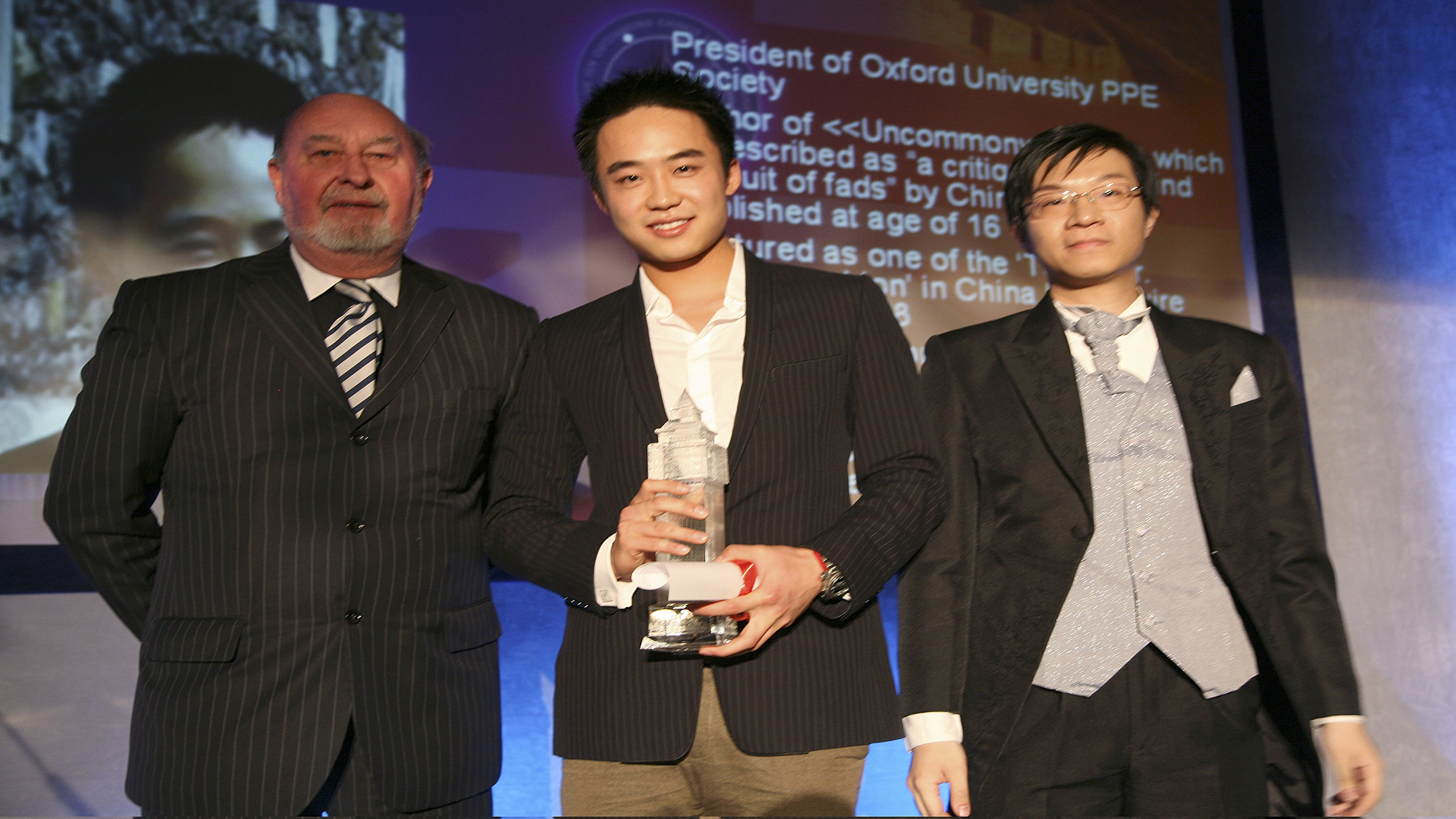 Bo Guagua (C), son of China's former Chongqing Municipality Communist Party Secretary Bo Xilai, poses for a photograph with officials after receiving the trophy for UK Ten Oustanding Chinese Young Persons in London, in this May 9, 2009 file photo. Bo Guagua, a 24-year-old descendant of Chinese Communist royalty, seemed destined to one day become a rich and powerful businessman in an economy that in his lifetime would become the world's largest. His pedigree, elite schooling, easy confidence and connections left those who knew him in no doubt he would pursue a business career and amass a fortune. That was until a British expatriate, Neil Heywood, died in November 2011 in a hotel in a huge city in western China, a world away from the clipped lawns and hushed libraries of Harvard University where Bo was studying. The story now looks certain to ruin his family and upend his ambitions. REUTERS/Stringer (BRITAIN - Tags: POLITICS CRIME LAW) CHINA OUT. NO COMMERCIAL OR EDITORIAL SALES IN CHINA - RTR30PIA